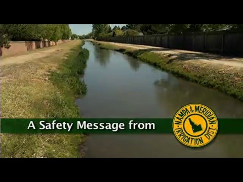 "Photo of a canal with the words ""A Safety Message From"" followed by the logo for Nampa & Meridian Irrigation District"