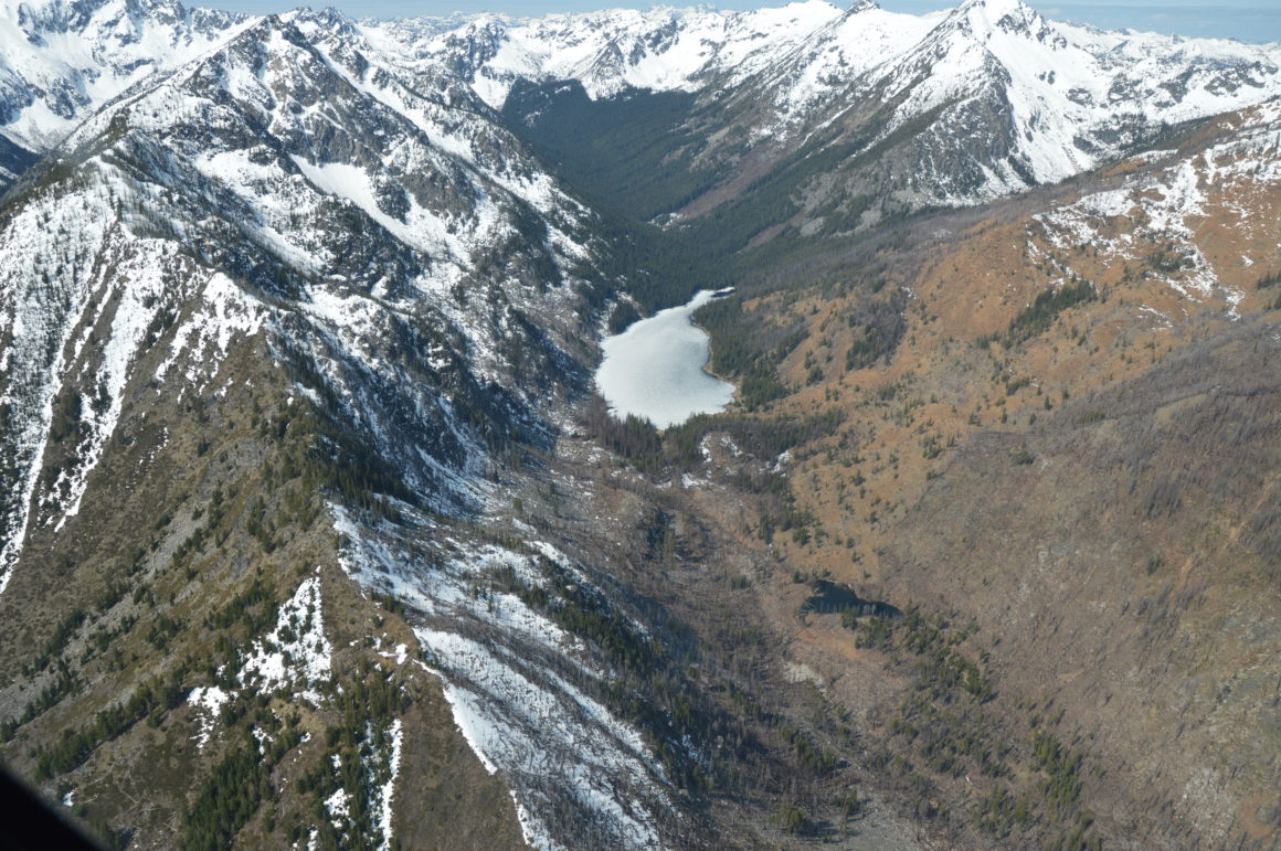 Aerial photo of Eight Mile Lake situated in the mountains