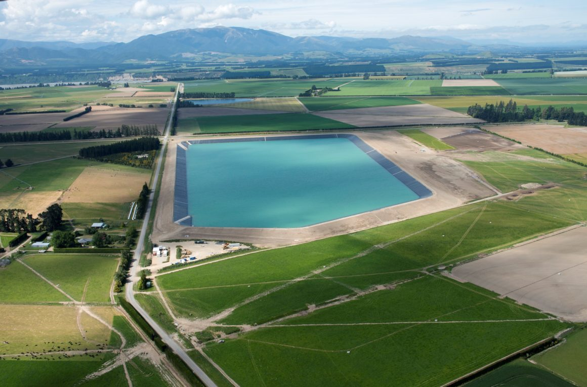 Aerial photo of Sheffield Reservoir. A square body of water surrounded by green grass.