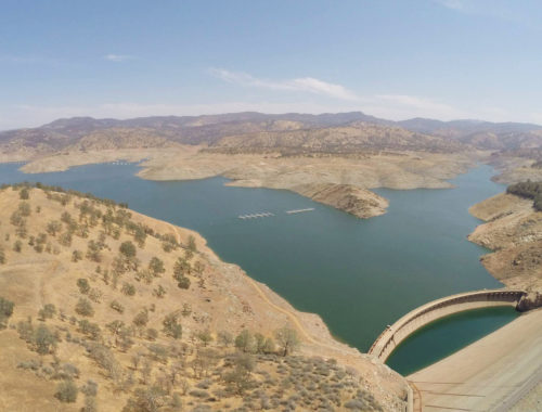 Photo of Lake McClure during a drought. The original Exchequer Dam, normally submerged, is exposed.