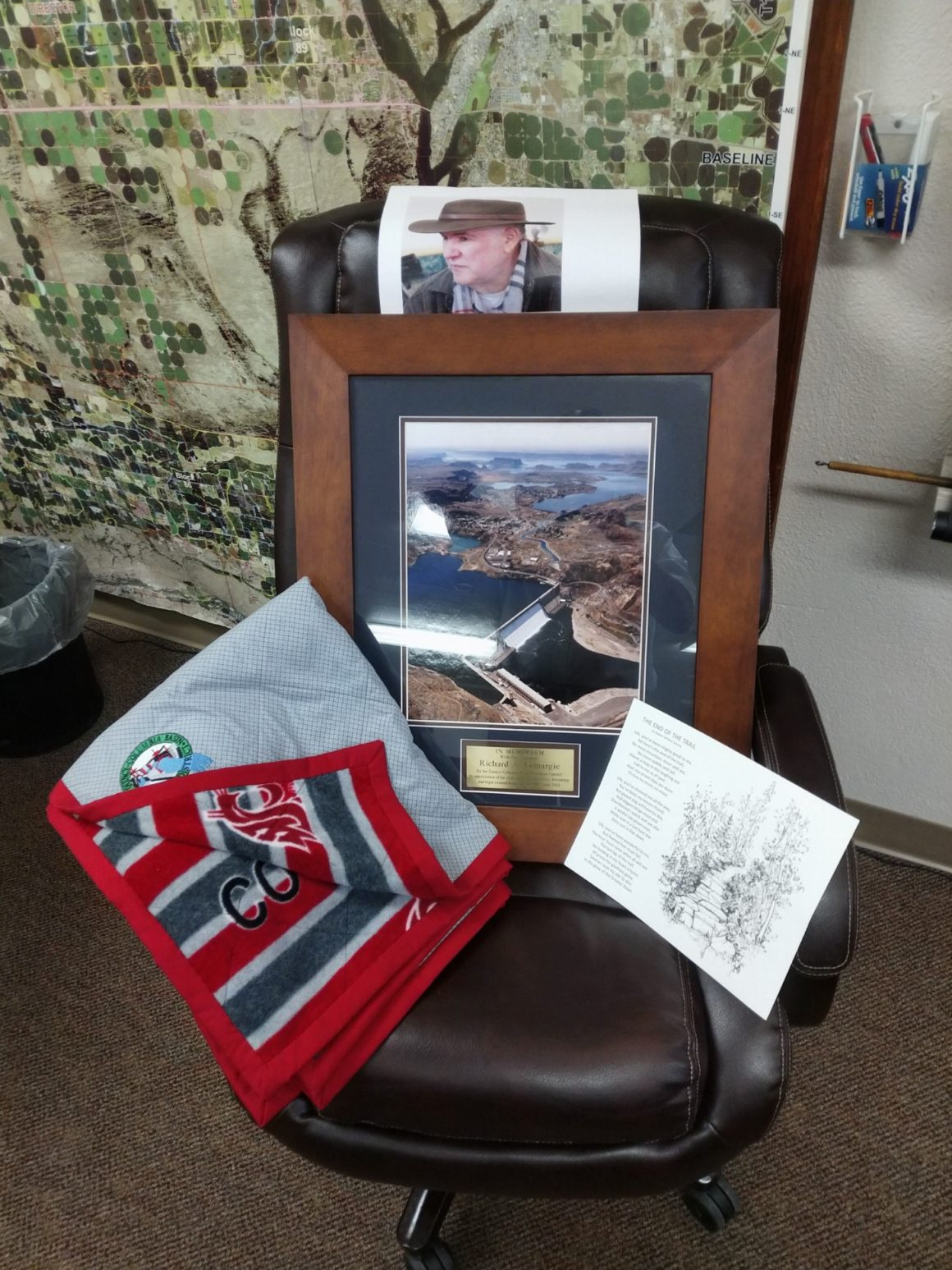 Photo of Richard Lemargie's rolling office chair covered in memorabilia
