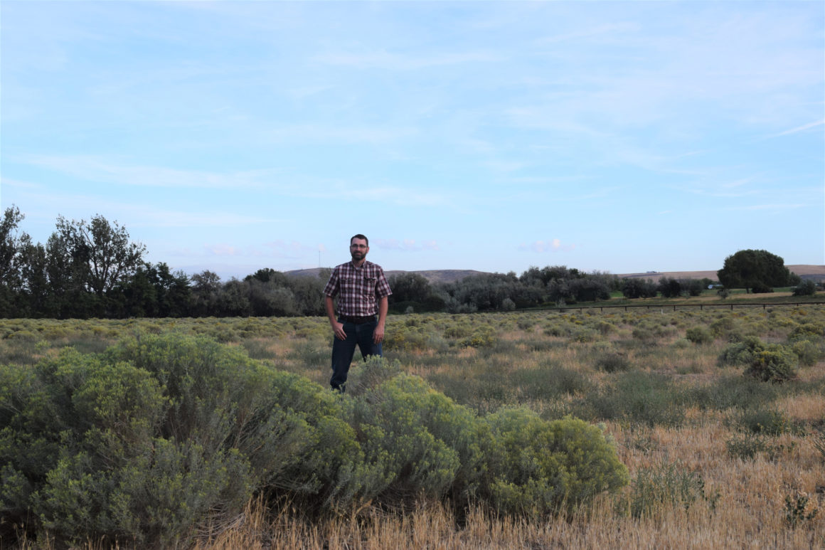 Photo of Clancy Flynn standing in a field