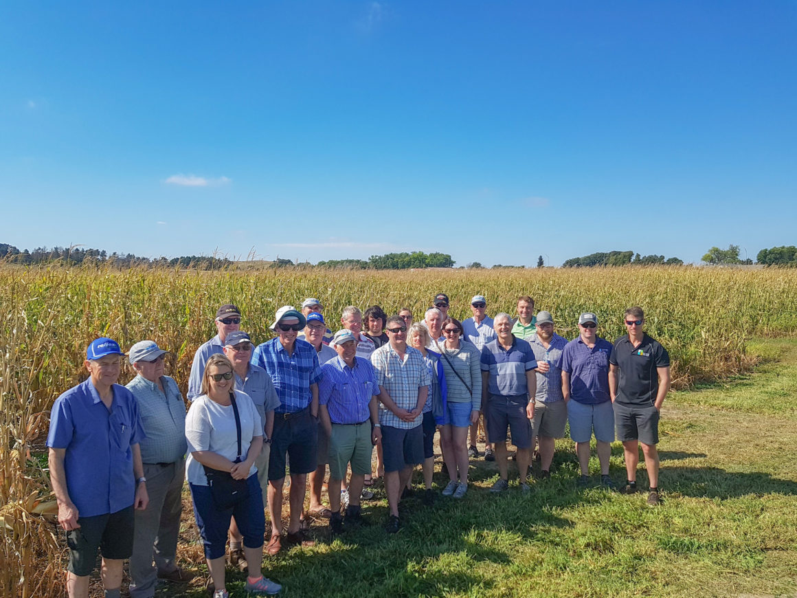 Group photo in front of a field
